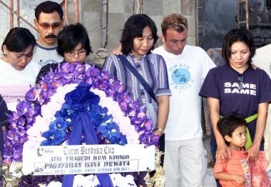 For our loved ones: Wives and children of the victims of the 2002 Bali bombings pray for their lost ones at Ground Zero, Kuta, Bali. JP