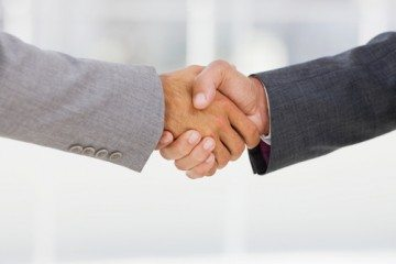 Businesspeople shaking hands together