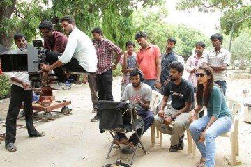 Director Srinath Ramalingam (seated, centre) and executive producer N. Shanmuga Sundaram (seated, second from right), on the set of Unakkenna Venum Sollu in Chennai, India. Photo: Ranjit Kumar